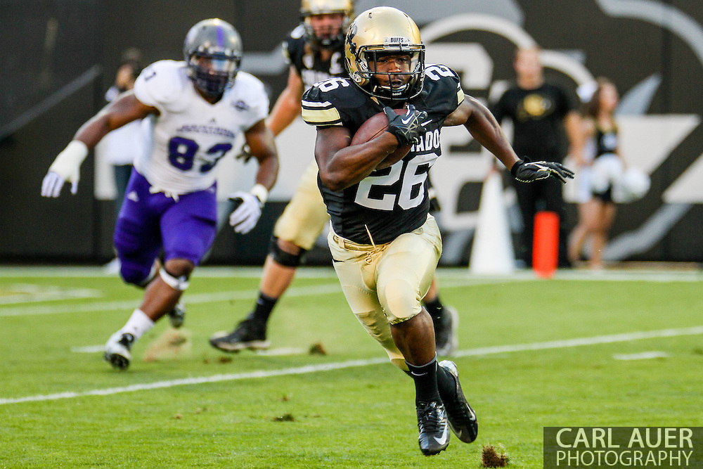 September 7th, 2013 - Colorado Buffaloes junior tail back Tony Jones (26) runs the ball towards the sideline in the first half of action in the NCAA football game between the University of Central Arkansas Bears and the University of Colorado Buffaloes at Folsom Field in Boulder, CO