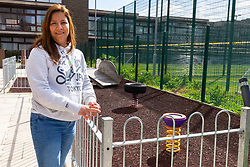 Mother of two Claudia Cifuentes, 39, stands outside a play area that has been constructed as an alternative for social housing tenants' children. Social housing residents are up in arms after having their children forbidden from using a play area overlooked by their homes as it is said to be only available to the children of those who have bought properties at the new Baylis Old School housing development in Lambeth, South London . London, March 26 2019.