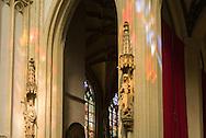 Nederland, Den Bosch, 20160723<br /> Beelden bij de ingang van de Sacramentskapel, rechts Sint Brigida. beschermheilige van het vee en links Sint Helena. vinder van het Heilige Kruis.<br /> Kathedraal St. Jan in Den Bosch.De Sint-Janskathedraal (voluit: de Kathedrale Basiliek van Sint-Jan Evangelist) in de binnenstad van 's-Hertogenbosch wordt veelal beschouwd als het hoogtepunt van de Brabantse gotiek. De kathedraal imponeert door zijn omvang en enorme rijkdom aan beeldhouwwerk. Uniek in Nederland zijn de dubbele luchtbogen en uniek in de wereld zijn de 96 luchtboogfiguren.De kerk in volle pracht op de Parade<br /> Sint-Janskathedraal<br /> <br /> Netherlands, Den Bosch<br /> Statues at the entrance of the Sacrament Chapel, St. Brigida right. patron saint of cattle and left St. Helena. finder of the Holy Cross.<br /> The St. John's Cathedral (in full: the Cathedral Basilica of St. John the Evangelist) in the city of 's-Hertogenbosch is often regarded as the pinnacle of Brabant Gothic. The cathedral impresses by its size and wealth of sculpture. Unique in the Netherlands are the double flying buttresses and unique in the world, the 96 flying buttress figures.<br /> St. John's Cathedral