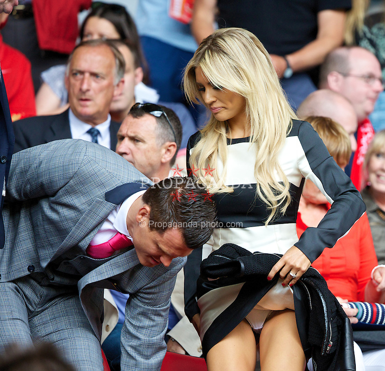 LIVERPOOL, ENGLAND - Saturday, August 3, 2013: Former Liverpool player John Arne Riise and his girlfriend during a preseason friendly match against Olympiakos CFP at Anfield. (Pic by David Rawcliffe/Propaganda)