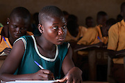 """Nuria, 15, is a student at Wungu School. ..She thinks that """"Girls should marry their books and give birth to education."""""""