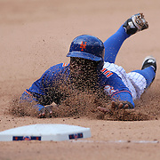 Dilson Herrera, New York Mets, dives into third base on a Curtis Granderson hit to set up the winning run in the Mets 2-1 win in 13 innings during the New York Mets Vs Cincinnati Reds MLB regular season baseball game at Citi Field, Queens, New York. USA. 28th June 2015. Photo Tim Clayton