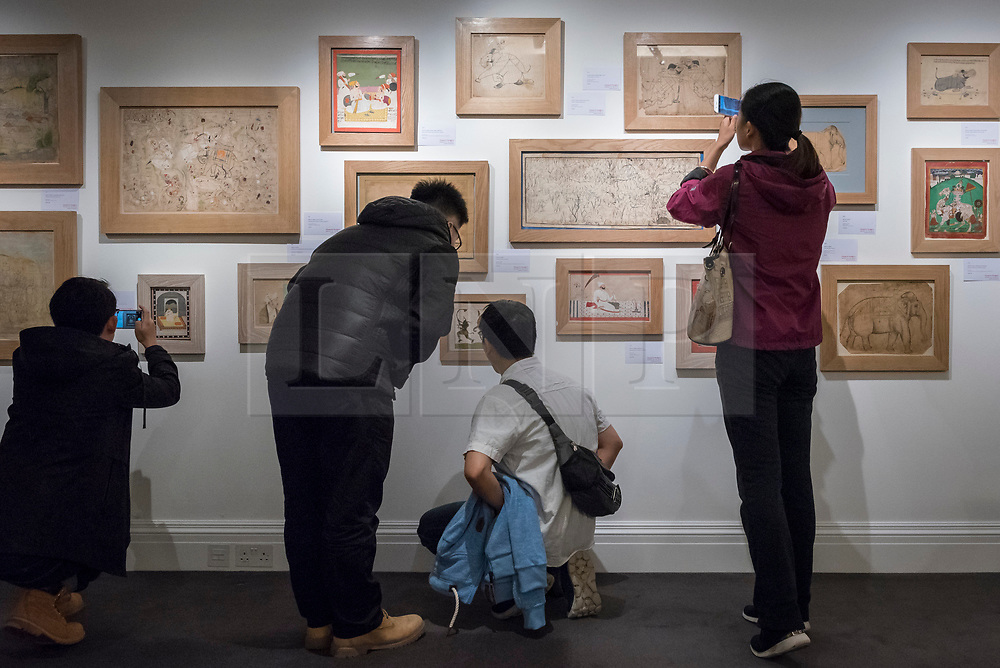 © Licensed to London News Pictures. 20/10/2017. London, UK. Visitors view various North Indian artworks, 18th century, from Howard Hodgkin's personal collection at a preview of Islamic, Middle Eastern and other artworks which be auctioned at Sotheby's New Bond Street on 24 and 25 October. Photo credit : Stephen Chung/LNP