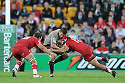Richie McCaw is wrapped up in the tackle of Anthony Faingaa ~ Super 15 rugby (Round 15) - Reds v Crusaders played at Suncorp Stadium, Brisbane, Australia on Sunday 29th May 2011 ~ Photo : Steven Hight (AURA Images) / Photosport