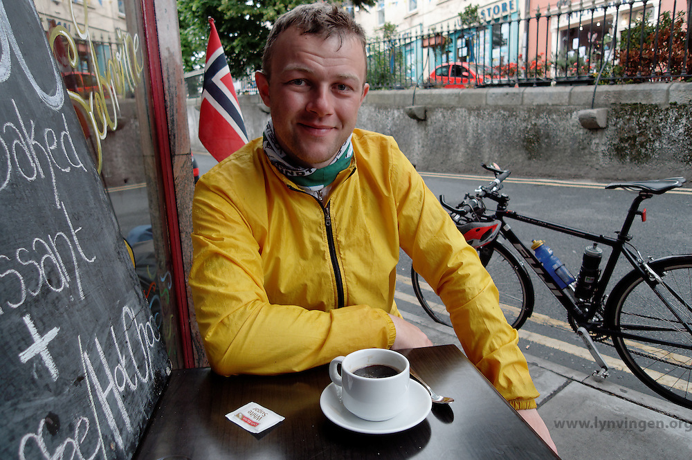 cyclist drinking coffee on a street cafe in Wicklow