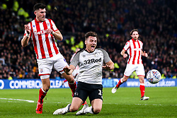 Chris Martin of Derby County takes on Danny Batth of Stoke City - Mandatory by-line: Robbie Stephenson/JMP - 31/01/2020 - FOOTBALL - Pride Park Stadium - Derby, England - Derby County v Stoke City - Sky Bet Championship