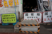 "Barriers erected outside the Occupy Kasumigasaki anti nuclear camp outside the METI building in Kasumigaseki, Tokyo, Japan. Friday April 12th 2013. The camp has been in place since September 2011 resisting several attempts to remove it. It now faces a court order restricting access and protestors have been served with a order to pay ""rent"" for their use of the land."