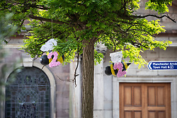 "© Licensed to London News Pictures . 22/05/2019. Manchester, UK . Two bees spelling out "" 22 "" hang from a tree in St Ann's Square . People in St Ann's Square in Manchester City Centre on the second anniversary of the Manchester Arena bombing following a private service in St Ann's Church . On the evening of 22nd May 2017 , Salman Abedi murdered 22 people and seriously injured dozens more , when he exploded a bomb in the foyer of the Manchester Arena as concert-goers were leaving an Ariana Grande gig . Photo credit: Joel Goodman/LNP"
