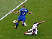 Photo: Glyn Thomas.<br />Italy v France. FIFA World Cup 2006 Final. 09/07/2006.<br /> Italy's Fabio Cannavaro (L) brings down Malouda for a penalty.