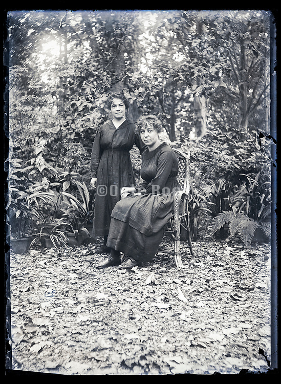 two women posing in garden setting France ca 1920s