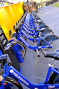 The Melbourne Bike Share program makes bicycles available for cheap hire throughout the city centre. Melbourne, Victoria, Australia