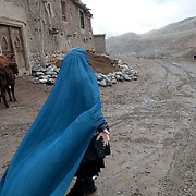 Takhar province. Nahrob village. Souhaila , village midwife, walking home.