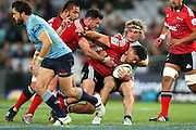 Codie Taylor tackled. NSW Waratahs v Canterbury Crusaders. Sport Rugby Union Super Rugby Representative Provincial. ANZ Stadium. 23 May 2015. Photo by Paul Seiser/SPA Images