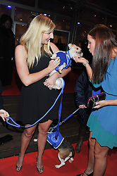 Left to right, Olympic Gold medal swimmer REBECCA ADLINGTON and Olympic swimmer JOANNE JACKSON and  Ondge the dog at the Battersea Dogs & Cats Home Collars & Coats Gala Ball held at Battersea Evolution, Battersea Park, London SW8 on 8th November 2012.