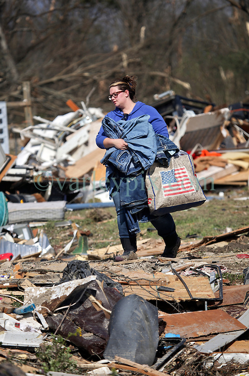 24 February 2016. Sugar Hill RV Park, Convent, Louisiana.<br /> Scenes of devastation following a deadly EF3 tornado touchdown. 2 confirmed dead. <br /> Meagan Thomas works with her family to recover all they can from their destroyed trailer.<br /> Photo©; Charlie Varley/varleypix.com
