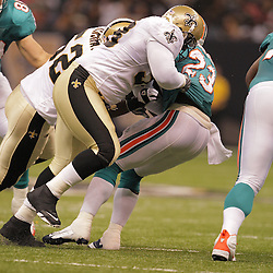 2008 August 28: New Orleans Saints defensive tackle Sedrick Ellis (98) tackles  Miami Dolphins running back Ronnie Brown (23) of the Miami Dolphins during their game at the Louisiana Superdome in New Orleans, LA.