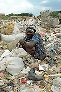Woman resting top of city dump LaMosca, Domincan Republic.