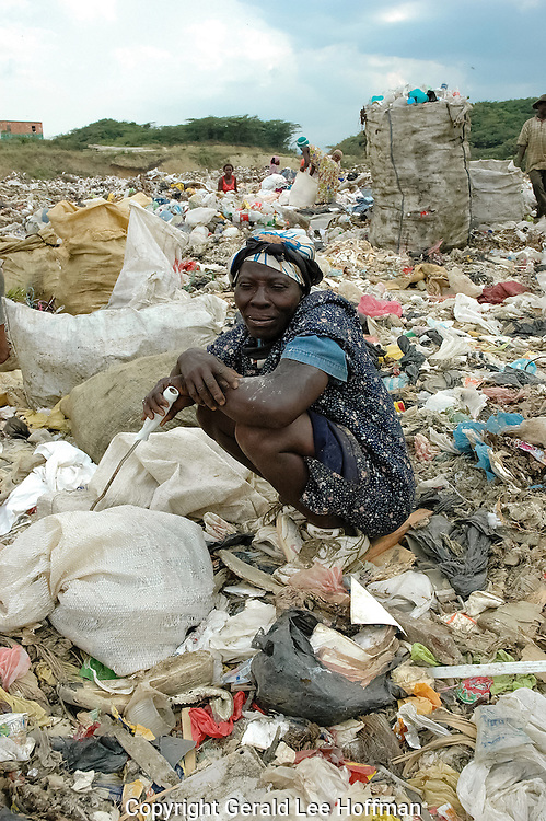 Woman resting top of city dump LaMosca, Domincan Republic.
