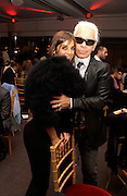 Carine Roitfeld and Karl Lagerfeld, Aids beneft during couture week, Pavilion D'Armee Nonville, 21 January 2004. © Copyright Photograph by Dafydd Jones 66 Stockwell Park Rd. London SW9 0DA Tel 020 7733 0108 www.dafjones.com