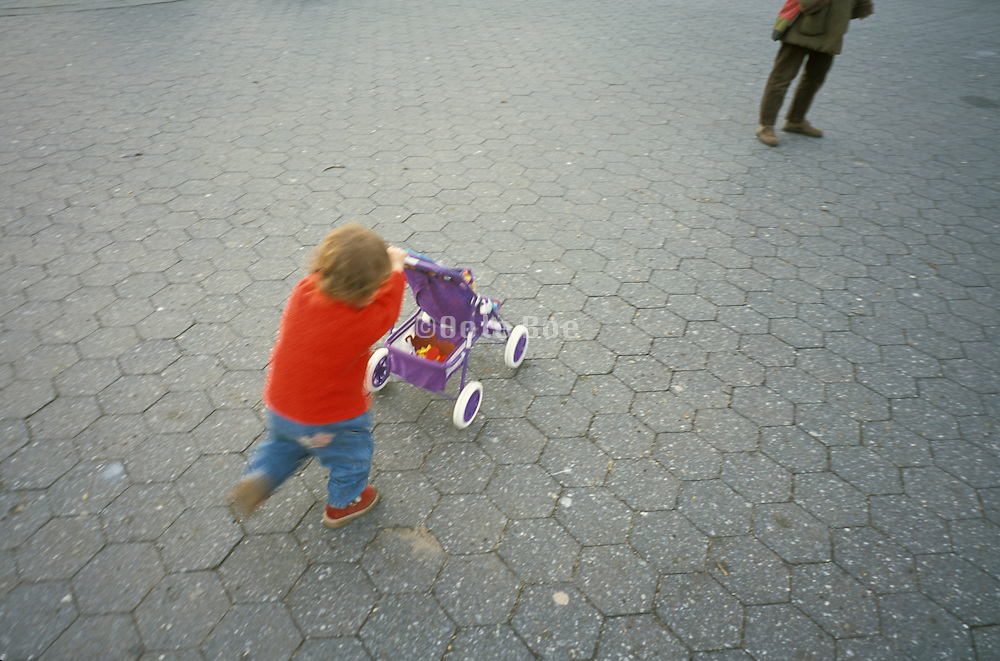 a child pushing a stroller