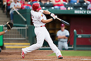 Stephen Piscotty (12) of the Springfield Cardinals makes contact on a pitch during a game against the Northwest Arkansas Naturals at Hammons Field on July 28, 2013 in Springfield, Missouri. (David Welker)