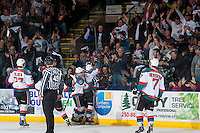 KELOWNA, CANADA - APRIL 18: Ryan Olsen #27, Rourke Chartier #14, Riley Stadel #3 and Damon Severson #7 of the Kelowna Rockets celebrates a goal with fans against the Portland Winterhawks on April 18, 2014 during Game 1 of the third round of WHL Playoffs at Prospera Place in Kelowna, British Columbia, Canada.   (Photo by Marissa Baecker/Shoot the Breeze)  *** Local Caption *** Riley Stadel; Ryan Olsen; Rourke Chartier; Damon Severson;