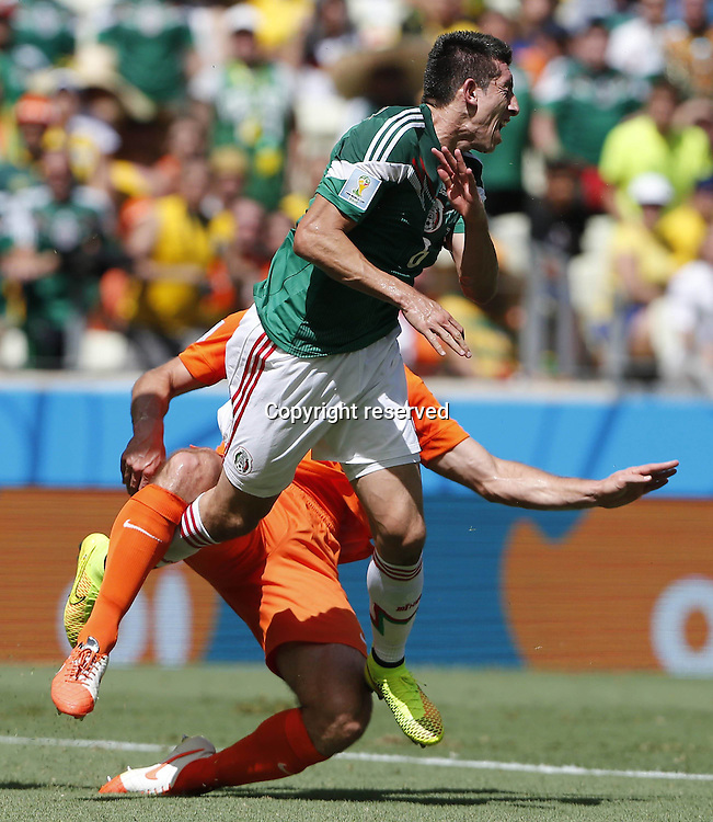 29.06.2014. Fortaleza, Brazil. Mexicos Hector Herrera with Netherlandss Ron Vlaar during a Round of 16 match between Netherlands and Mexico of 2014 FIFA World Cup at the Estadio Castelao Stadium in Fortaleza, Brazil, on June 29, 2014.