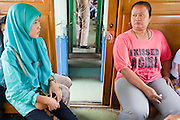 "Sept. 26, 2009 -- YALA, THAILAND: Muslim and Buddhist Thais sit opposite each other on a train going from Pattani to Yala in southern Thailand. Thailand's three southern most provinces; Yala, Pattani and Narathiwat are often called ""restive"" and a decades long Muslim insurgency has gained traction recently. Nearly 4,000 people have been killed since 2004. The three southern provinces are under emergency control and there are more than 60,000 Thai military, police and paramilitary militia forces trying to keep the peace battling insurgents who favor car bombs and assassination.  Photo by Jack Kurtz / ZUMA Press"