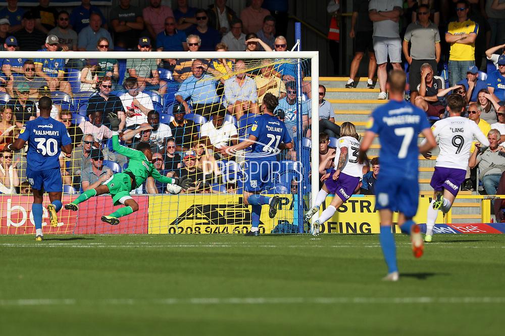 Shrewsbury Town attacker Jason Cummings (35) scoring goal to make it 1-1 during the EFL Sky Bet League 1 match between AFC Wimbledon and Shrewsbury Town at the Cherry Red Records Stadium, Kingston, England on 14 September 2019.