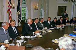United States President George H.W. Bush meets with bipartisan, bicameral Congressional budget negotiators in the Cabinet Room of the White House in Washington, D.C. on May 15, 1990. Recognizable, from left to right: US House Minority Leader Bob Michel (Republican of Illinois), US House Majority Leader Dick Gephardt (Democrat of Missouri), Speaker of the US House of Representatives Tom Foley (Democrat of Washington), President Bush, US Senate Majority Leader George Mitchell (Democrat of Maine), and US Senate Minority Leader Bob Dole (Republican of Kansas), unidentified, US Senator Pete Domenici (Republican of New Mexico), US Senator Lloyd Bentsen (Democrat of Texas), and US Senator Bob Packwood (Republican of Oregon). Photo by Ron Sachs / CNP /ABACAPRESS.COM