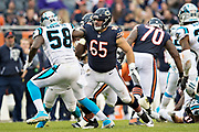CHICAGO, IL - OCTOBER 22:  Cody Whitehair #65 of the Chicago Bears chases pass blocks Thomas Davis #58 of the Carolina Panthers at Soldier Field on October 22, 2017 in Chicago, Illinois.  The Bears defeated the Panthers 17-3.  (Photo by Wesley Hitt/Getty Images) *** Local Caption *** Cody Whitehair; Thomas Davis