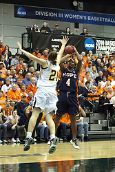 19 March 2010: Melissa Alwardt is too late to stop a shot by Philana Greene. The Flying Dutch of Hope College defeat the Yellowjackets of the University of Rochester in the semi-final round of the Division 3 Women's Basketball Championship by a score of 86-75 at the Shirk Center at Illinois Wesleyan in Bloomington Illinois.