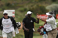 Dwight Yorke and Caddie Kirk Kuzmanic high five as they walk up the 18th fairway, Caddie Glen Murray (L) looks on during round 2 of the Gary Player Invitational presented by Coca-Cola and held at Fancourt in George on the 21st November 2010..Photo by Shaun Roy/SPORTZPICS