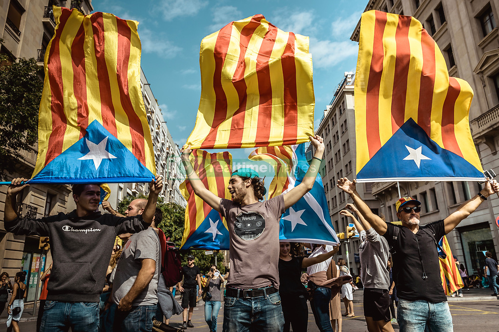 October 3, 2017 - Barcelona, Catalonia, Spain - Thousands of Catalan pro-independence activists shout slogans as they march through Barcelona during a general strike in defense of rights and freedoms after police violence during the secession referendum at October 1st. Spain's Central Government denies that there have been a referendum and does not accept the result as the Catalan referendum law had been suspended by Spain's constitutional court (Credit Image: © Matthias Oesterle via ZUMA Wire)