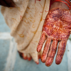 A VHW shows off a henna tattoo on her hand.