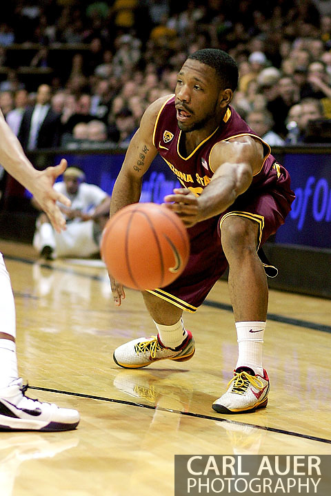 February 16th, 2013 Boulder, CO - Arizona State Sun Devils junior guard Evan Gordon (10) passes the ball in towards the basket during the NCAA basketball game between the Arizona State Sun Devils and the University of Colorado Buffaloes at the Coors Events Center in Boulder CO