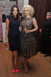 Left to right, LISA SNOWDON and IMMODESTY BLAIZE at a party to celebrate the announcement of the 20 shortlisted designers for the UK final of the Triumph Inspiration Award 2011 held at the home of Charlotte Stockdale, 8 Francis Street, London SW1 on 31st March 2011.
