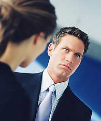 Businessman looking distant with Woman in front of him