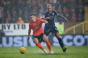 30th August 2019; Dens Park, Dundee, Scotland; Scottish Championship, Dundee Football Club versus Dundee United; Cammy Smith of Dundee United challenges for the ball with Jordon Forster of Dundee