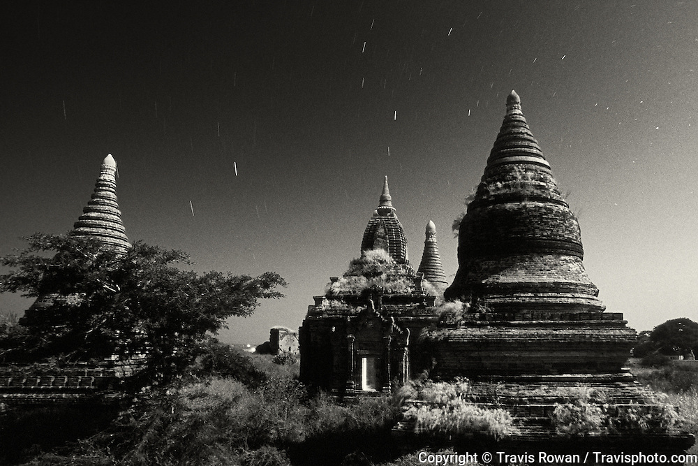 Ancient temples in the Bagan region of Myanmar illuminated by moonlight.