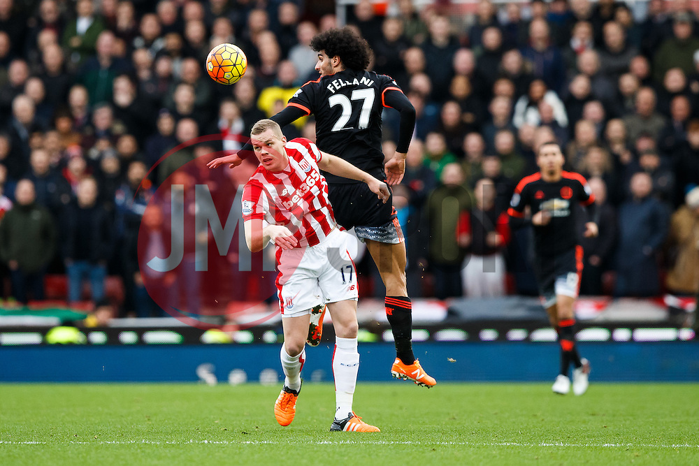 Ryan Shawcross of Stoke City and Marouane Fellaini of Manchester United compete in the air - Mandatory byline: Rogan Thomson/JMP - 26/12/2015 - FOOTBALL - Britannia Stadium - Stoke, England - Stoke City v Manchester United - Barclays Premier League - Boxing Day Fixture.