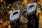 A helicopter night view of Columbus Circle and the Time Warner Center towers.