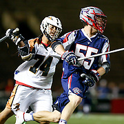 Eric Martin #55 of the Boston Cannons keeps the ball away from Miles Thompson #74 of the Rochester Rattlers during the game at Harvard Stadium on August 9, 2014 in Boston, Massachusetts. (Photo by Elan Kawesch)
