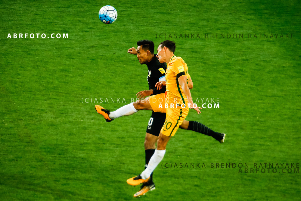 MELBOURNE, AUSTRALIA - SEPTEMBER 5 : Teerasil Dangda of Thailand and Trent Sainsbury of the Australia Socceroos go up for a header during the Stage 3 Group World Cup Football Qualifiers between Australia Vs Thailand at the Melbourne Rectangular Stadium, Melbourne, Australia 5 September 2017.