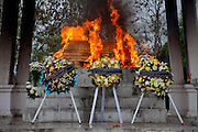 Laotian cremation ceremony at Luang Prabang's central crematorium in Ban Vieng Mai for Mr. Voua Sy Amkha, 63, a propaganda official for the Lao government in Luang Prabang who died of a stroke. Before and after the cremation, his family gathered in the family home with relatives and monks from their Buddhist temple in Ban Navieng Kham village, a suburb of Luang Prabang, Laos.