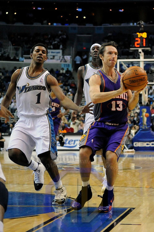 07 December 2007:   Phoenix Suns guard Steve Nash (13) makes one of his season high 19 assists  in the second half against Washington Wizards forward Nick Young (1) at the Verizon Center in Washington, D.C.  The Suns defeated the Wizards 122-107.
