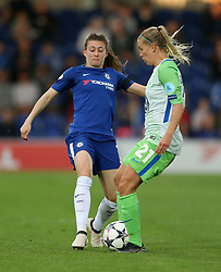 Chelsea Ladies' Hannah Blundell and Wolfsburg Ladies' Lara Dickenmann battle for the ball during the UEFA Women's Champions League, Semi Final First Leg match at the Cherry Red Records Stadium, Kingston.