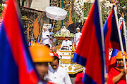 "05 FEBRUARY 2013 - PHNOM PENH, CAMBODIA:  King Father Norodom Sihanouk's ashes ride through Phnom Penh on their way to the Royal Barge that will take them up the Mekong River. Sihanouk's ashes will be scattered in locations across Cambodia. Tuesday, they were scattered on the Mekong River. Norodom Sihanouk (31 October 1922 - 15 October 2012) was the King of Cambodia from 1941 to 1955 and again from 1993 to 2004. He was the effective ruler of Cambodia from 1953 to 1970. After his second abdication in 2004, he was given the honorific of ""The King-Father of Cambodia."" Sihanouk died in Beijing, China, where he was receiving medical care, on Oct. 15, 2012.   PHOTO BY JACK KURTZ"