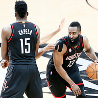 03 May 2017: Houston Rockets guard James Harden (13) drives past San Antonio Spurs guard Danny Green (14) on a screen set by Houston Rockets center Clint Capela (15) during the San Antonio Spurs 121-96 victory over the Houston Rockets, in game 2 of the Western Conference Semi Finals, at the AT&T Center, San Antonio, Texas, USA.