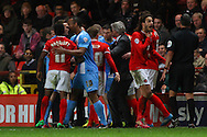 Players and the managers come together during the Sky Bet Championship match at The Valley, London<br /> Picture by David Horn/Focus Images Ltd +44 7545 970036<br /> 15/04/2014